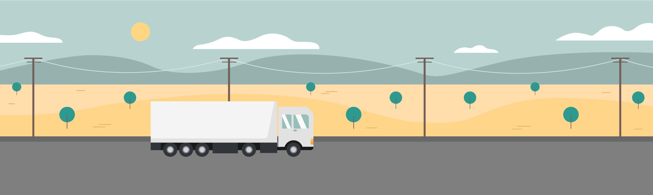 Un camión pasando por el campo de cultivo